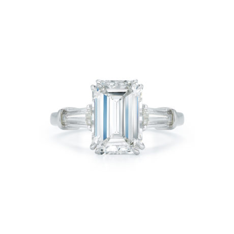 2.99 Carat Emerald-Cut Diamond Three Stone Engagement Ring by Marshall Pierce & Company Tapered Bag Side Stones in Platinum Side View