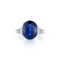6.75 Carat Oval Sapphire Ring Trillion Cut Diamond Side stones platinum Marshall Pierce & Company Chicago Fine Jewelry three stone ring